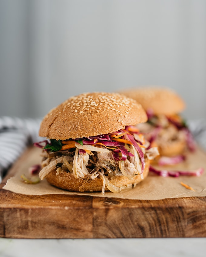 This crockpot version of apple cider pulled pork is an easy, kid friendly recipe for fall. It's gluten free, sweet and savory, and pairs perfectly with an apple cider vinegar slaw. We love it in a pulled pork sandwich and save the leftovers for quick and easy lunch prep salads. #glutenfree #applecider #pulledpork #recipe #crockpot