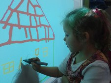 Maja drawing the windowframe