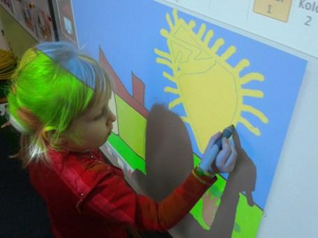 Iza drawing the sun