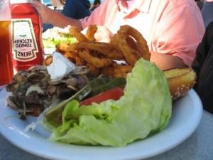 Mushroom burger with onion rings