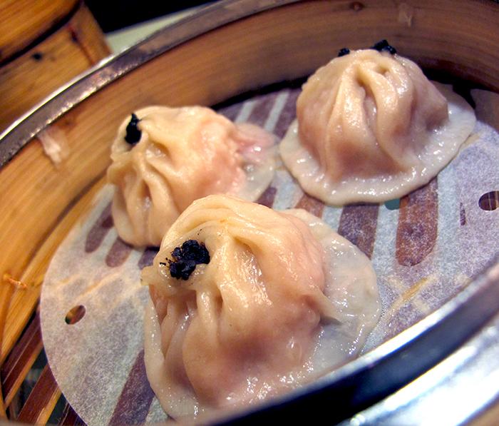 Shanghai Soup Dumplings with Black Truffle http://ourtastytravels.com/blog/dimdimsum-dim-sum-hong-kong/ #dimsum #hongkong #ourtastytravels