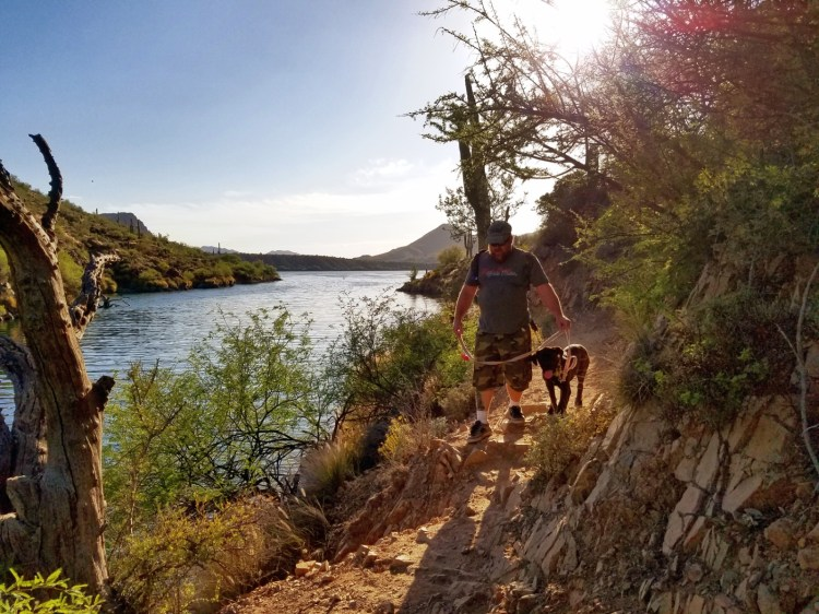 Hiking Butcher Jones Trail  - Hiker and dog on the trail at Butcher Jones Trail,  Saguaro Lake,  Arizona
