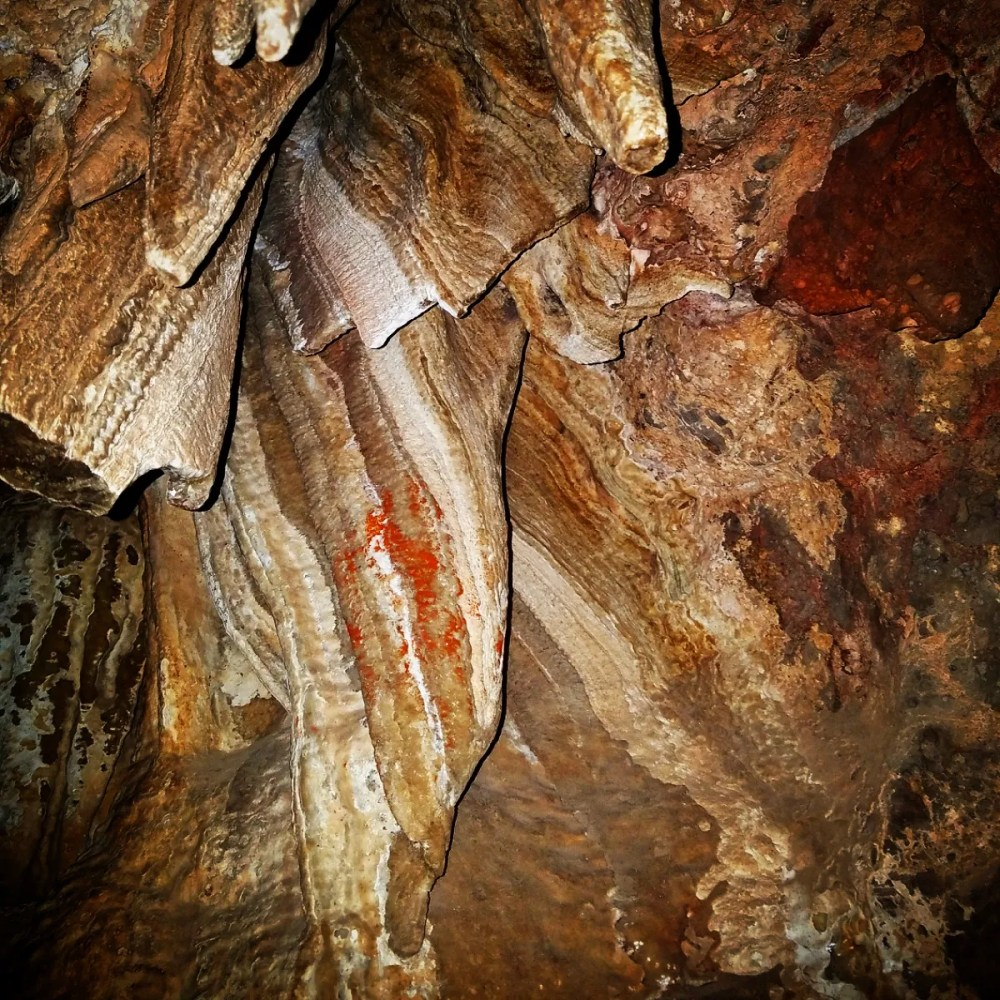 Bacon anyone? This formation hangs from the ceiling of the cave and is called bacon because its wavy shape and color striations