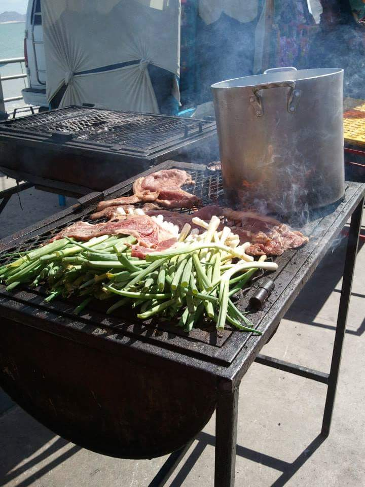 Fresh grilled carne asada and green onions for delicious street tacos on the malecon