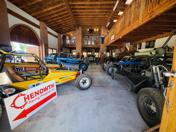 Chenowth Racing Products sign sits among the cars at Chenowth Museum in Baja