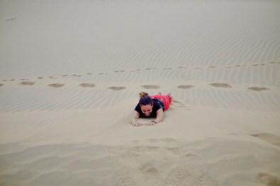 rolling in the dunes like a little kid