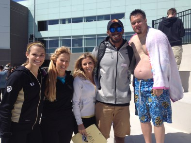 Brooke and Obum with coaches and athlete