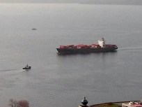 A tugboat meeting a large ship.