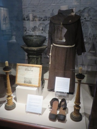 Mission artifacts including friar clothing and accessories