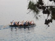 A rowing crew -- or shall I say paddling as they used canoe paddles, not oars -- passed by as we ate.