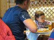 This little girl seemed to be enjoying her pizza.
