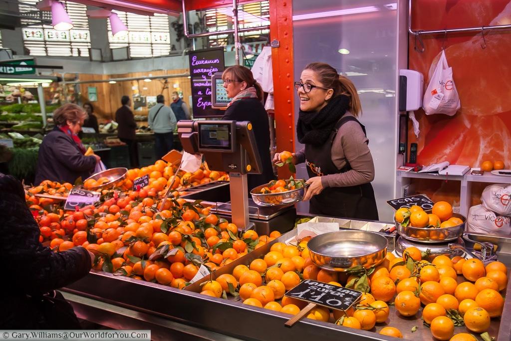 An Orange seller in the Mercado Central, Valencia, Spain