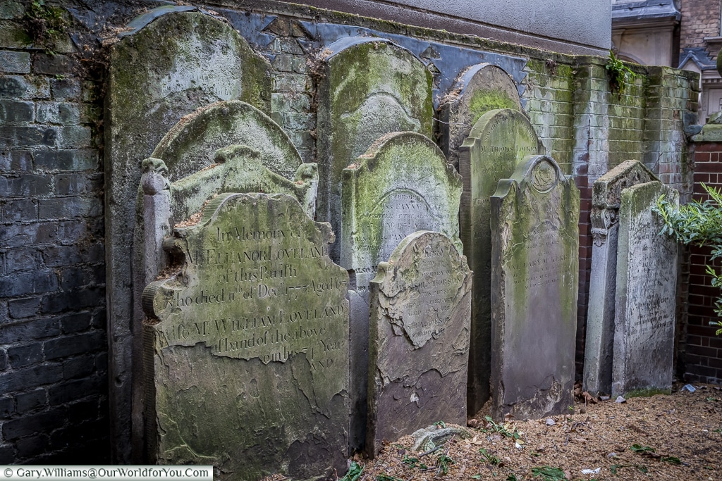 Gravestones at St Botolph's Aldersgate within the Postman's Park, City of London, UK