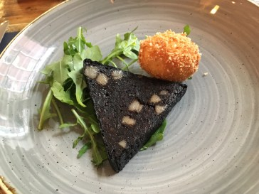 Doreen's black pudding served with a golden crispy hen's egg