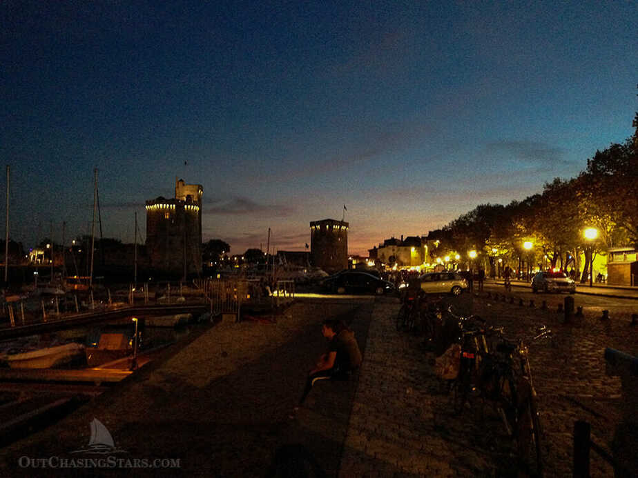 Photo of La Rochelle Harbour and Towers at night.