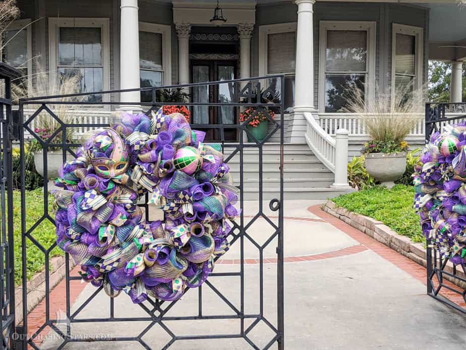 Home with Mardi Gras decorations on Galveston tree sculpture tour.