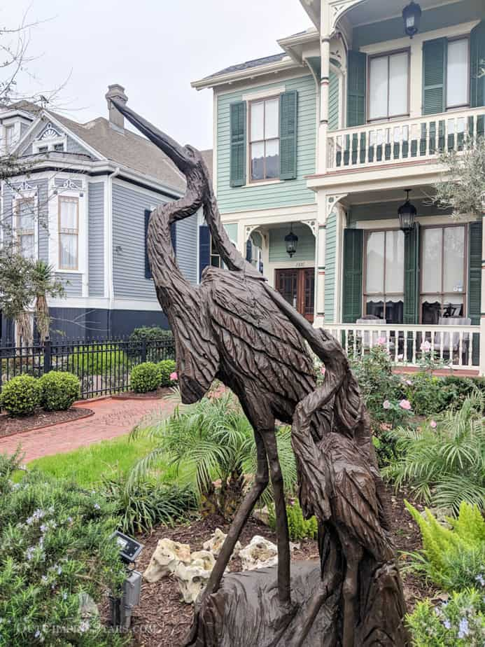 Wood carving of egrets on Galveston tree sculpture tour.