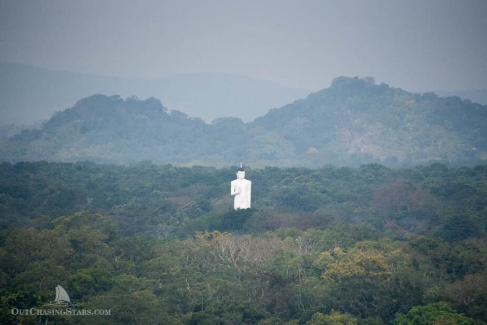 Buddha statue at Sigiriya Temple as viewed from Sigiriya rock.