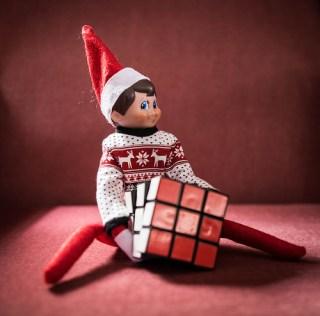 Elf on the shelf solves a Rubik Cube