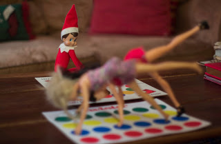 Elf on the shelf with Barbie playing twister