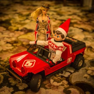 Elf on the Shelf in Dune buggy with Barbie