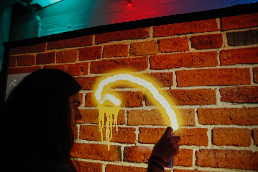Using Air Graffiti spray can on a projected brick background