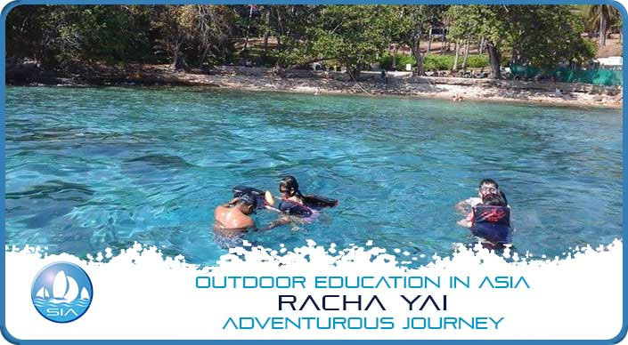 Swimming at a private beach on Racha Yai Adventurous Journey