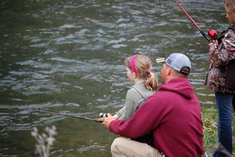 father fishing with daughter
