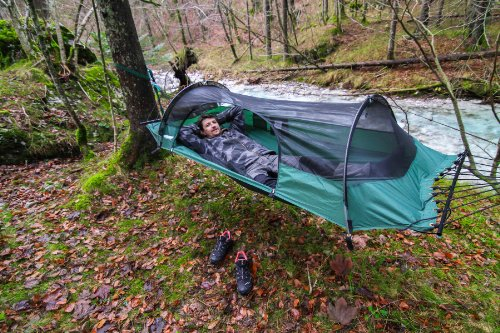 """Lawson Hammock Blue Ridge Camping Hammock and Tent (Rainfly and Bug Net Included) RATED #1: By Backpacker, Outside and American Survival Guide. Champ of the renowned Gear Of The Year Award.  HAMMOCK AND A TENT IN ONE: Patented plan with a one of a kind curve shaft/spreader bar framework that takes into account utilize suspended between two articles/trees as a loft or on the ground as a tent/bivy.  USE ANYWHERE: Most adaptable tent loft on the planet. Ideal for a wide range of outdoors; auto outdoors, hiking, bicycle outdoors, Scouting, kayak/kayak outdoors or notwithstanding relaxing sans bug in the backyard.  HAMMOCKING COMFORT REDESIGNED: Design keeps loft bed compliment, disposing of a great part of the """"case/banana"""" impact made by different lofts. Mull over your side, move over and wake up without a throbbing back!"""
