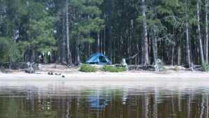 Two Person Tent on the Edge of a Lake