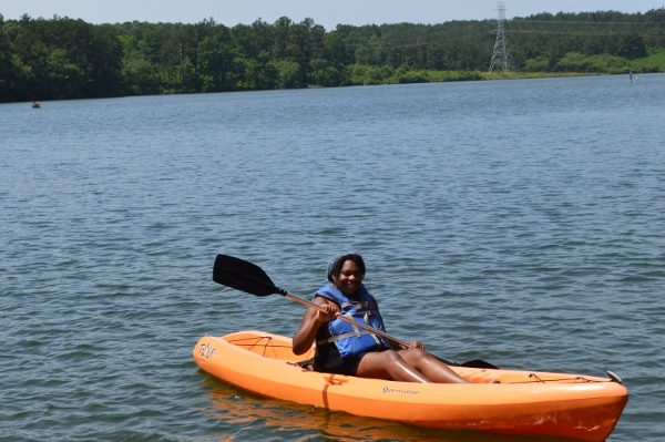 black woman kayaking