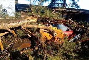 Debris buries a car in Elizabeth City. (Jessica Weatherly)