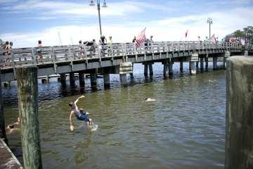 The timeless joy of childhood as kids jump in Doughs Creek. Photo, Kip Tabb