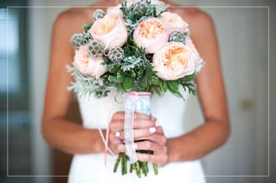 Outer Banks Wedding Guide - Bride holding bouquet to her chest.