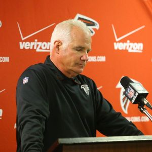Atlanta head coach Mike Smith faces the media after a humiliating loss Sunday (Photo Credit: Curtis Compton/AJC)