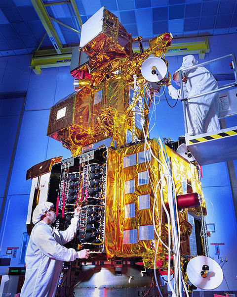 Technicians working on Landsat 7 before its 1999 launch. Landsat 7 and 8 are now in orbit, providing new images of the Earth's surface every eight days. Photo credit: NASA