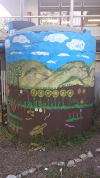 The 3,000-gallon catchment tank that sits in the garden.