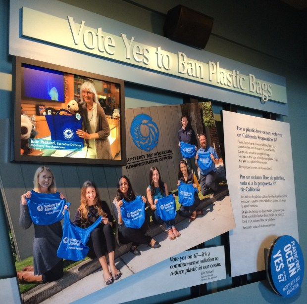 """Vote Yes to Ban Plastic Bags"" Campaign display at the Monterey Aquarium. CEO Julie Packard is featured top left."