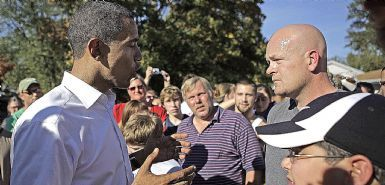 Democratic presidential candidate, Sen. Barack Obama, D-Ill., left, answers a question from plumber Joe Wurzelbacher in Holland, Ohio, Sunday, Oct. 12, 2008. (AP Photo/Jae C. Hong) Pic. Ap
