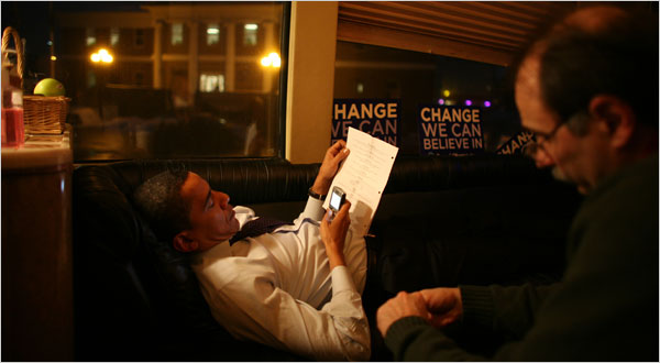 Senator Barack Obama with two campaign constants - his BlackBerry and his chief strategist, David Axelrod.