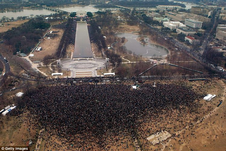 Crowds gather at the Lincoln Memorial on the National Mall in Washington D.C. for the opening ceremony of Mr Obama's inauguration
