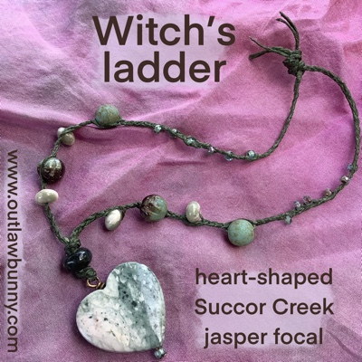 Witch's ladder with heart-shaped Succor Creek jasper focal
