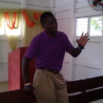 Pastor Shadrac gives instructions before going out to evangelize