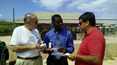 Dr. Jerry Graham, director of Baptist Medical Mission, the left white Polo Shirt.