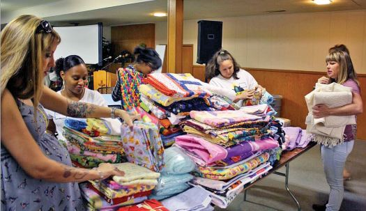 Photo courtesy Elizabeth House Elizabeth House residents received the opportunity to shop for blankets during a recent workshop.