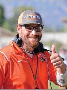 Polytechnic head football coach Chris Schmoke didn't hesitate to partner up with Hillsides to host football clinics for underprivileged kids.