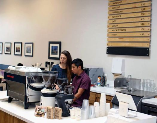 Photo courtesy Rosebud Rosebud manager Stephanie Sharp trains intern Jonathan Tran. The Rosebud was created to provide a vibrant community space, delicious coffee and skilled job training for formerly homeless youth or at-risk former foster youth.