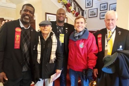 Photo courtesy Furrey family La Cañada Flintridge resident Jerry Furrey (second from left) and his son Brett (far right) had their family car featured as new Rose Bowl Hall of Fame inductees Randall McDaniel (left) and Vince Young rode in the classic 1940 Lincoln Mark I in the Rose Parade on New Year's Day. McDaniel, a former NFL and Arizona State offensive lineman, and Young, the quarterback who led Texas to a come-from-behind 41-38 victory over USC in the 2006 Rose Bowl, were joined in the recent Hall of Fame class by two posthumous selections: legendary Stanford coach Pop Warner and Chicago Bears founder George Halas.