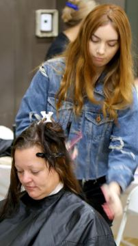 A Citrus College cosmetology student volunteer offers a free haircut at the Pasadena Salvation Army's Homeless Connect Day. Personal grooming was one of the many services offered to area homeless recently.