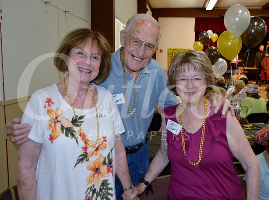 """Ellie Wildermuth (left) and Joan Williams help Don Williams celebrate his 86th birthday at the""""Swingin' Seniors"""" event at the Community Center"""